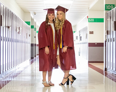 Hanna Rudkin and Kaitie Regnier pose for a photo in the school hallway prior to the 2019 Richmond-Burton Commencement Ceremony Sunday, May 26, 2019 in Richmond.   KKoontz – For Shaw Media