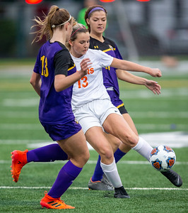 Crystal Lake Central's Taylor Bittenbender drives the ball between Wauconda defenders in the IHSA Class 2A Supersectional game Tuesday, May 28, 2019 in Grayslake. Wauconda gets the 2-1 win to advance to the State Semifinals. KKoontz – For Shaw Media