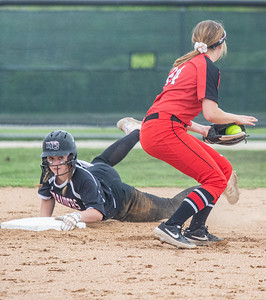 Huntley's Abigail Simandl slides into second in the top of the fourth inning against Barrington in the Class 4A Hampshire Softball Sectional semifinal Wednesday, May 29, 2019 in Hampshire. Huntley gets the victory 6-1 and will face McHenry in an all Fox Valley Conference Sectional final on Saturday, June 1, 2019. KKoontz – For Shaw Media
