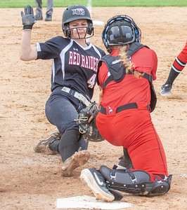 Huntley's Taylor Zielinski is tagged out at home in the top of the seventh inning against Barrington in the Class 4A Hampshire Softball Sectional semifinal Wednesday, May 29, 2019 in Hampshire. Huntley gets the victory 6-1 and will face McHenry in an all Fox Valley Conference Sectional final on Saturday, June 1, 2019. KKoontz – For Shaw Media