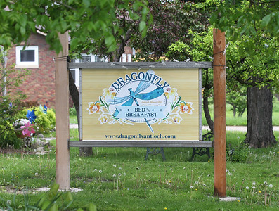 Candace H. Johnson-For Shaw Media A sign welcoming visitors sits in the front yard of the Dragonfly Bed and Breakfast on Main Street in downtown Antioch. (5/28/19)