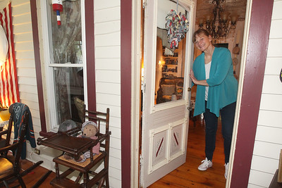 Candace H. Johnson-For Shaw Media Sheri Gronert, owner, greets visitors at the Dragonfly Bed and Breakfast on Main Street in downtown Antioch. (5/28/19)