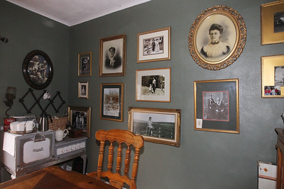 Candace H. Johnson-For Shaw Media Old family photos hang in the dining room and throughout the house at the Dragonfly Bed and Breakfast on Main Street in downtown Antioch. (5/28/19)