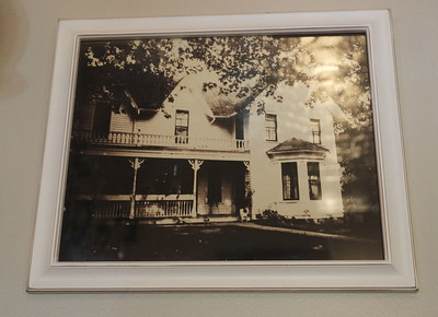 Candace H. Johnson-For Shaw Media A old photo of the house taken in 1915 hangs on the wall at the Dragonfly Bed and Breakfast on Main Street in downtown Antioch. (5/28/19)