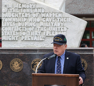 Candace H. Johnson-For Shaw Media Guest speaker Hal Burke,of Westmont, retired U.S. Navy, addresses the crowd during the Annual Memorial Day Ceremony at the Gurnee Memorial on O'Plaine Road in Gurnee. The ceremony was presented by the American Legion Post 771 and the Village of Gurnee. (5/27/19)