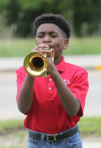 """Candace H. Johnson-For Shaw Media Viking Middle School's Noah Brown, 12, of Wadsworth with the 6th grade band plays,"""" Taps,"""" on his trumpet during the Annual Memorial Day Ceremony at the Gurnee Memorial on O'Plaine Road in Gurnee. The American Legion Post 771 and the Village of Gurnee hosted the ceremony. (5/27/19)"""