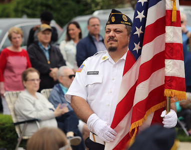 Candace H. Johnson-For Shaw Media David Jimenez, of Kenosha, Wis., with American Legion Post 771, holds the American flag during the Annual Memorial Day Ceremony at the Gurnee Memorial on O'Plaine Road in Gurnee. The American Legion Post 771 and the Village of Gurnee hosted the ceremony. (5/27/19)