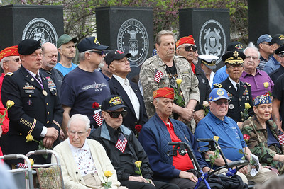 "Candace H. Johnson-For Shaw Media Veterans of all ages came together to hear Rebecca Rivera sing, ""Amazing Grace,"" during the Memorial Day Ceremony at the Lindenhurst Veterans Memorial.  (5/27/19)"