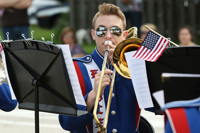 "Candace H. Johnson-For Shaw Media Nick Weilbaker with the Lakes Community High School band plays, ""Armed Forces Medley,"" on his trombone during the Memorial Day Ceremony at the Lindenhurst Veterans Memorial.  (5/27/19)"