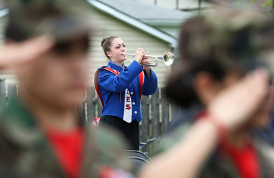 "Candace H. Johnson-For Shaw Media Olivia Huber with the Lakes Community High School band plays, ""Taps with Echoes,"" on her trumpet during the Memorial Day Ceremony at the Lindenhurst Veterans Memorial.  (5/27/19)"