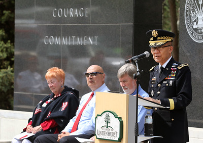 Candace H. Johnson-For Shaw Media Guest speaker Major General James Mukoyama, Jr. of Glenview addresses the crowd during the Memorial Day Ceremony at the Lindenhurst Veterans Memorial. Mukoyama, Jr. is a major general, United States Army, and retired president and chief executive officer of Military Outreach USA.  (5/27/19)
