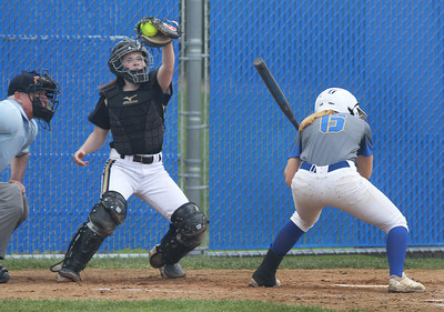Candace H. Johnson-For Shaw Media Grayslake North's Meghan Delahunty catches the pitch with Warren's Ashlyn Kitter up to bat in the first inning during the Class 4A regional final at Warren Township  High School. Warren won 4-1. (5/25/19)