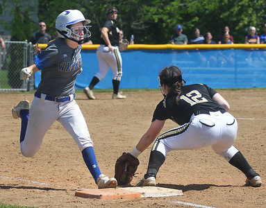 Candace H. Johnson-For Shaw Media Warren's Brooke Mangler gets safely to first against Grayslake North's Caitlin Berenbaum in the sixth inning during the Class 4A regional final at Warren Township  High School. Warren won 4-1. (5/25/19)