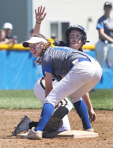 Candace H. Johnson-For Shaw Media Grayslake North's Ella Smith shows she slid in safely under the tag of Warren's Brooke Mangler at second in the seventh inning during the Class 4A regional final at Warren Township  High School. Warren won 4-1. (5/25/19)