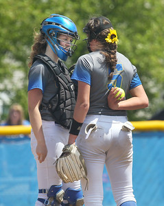 Candace H. Johnson-For Shaw Media Warren's Carissa Topolinski talks with pitcher Caitlyn Britton in the fifth inning during the Class 4A regional final at Warren Township  High School. Warren won 4-1. (5/25/19)