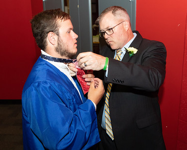 Principle Kevin Shelton assists Tyler Weishaar in tying his bow tie prior to the 2019 Johnsburg High School Commencement ceremony Friday, May 31, 2019 in Johnsburg. KKoontz – For Shaw Media