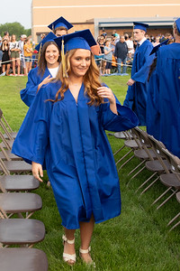 Cassy Huemann makes her way to her seat at the 2019 Johnsburg High School Commencement ceremony Friday, May 31, 2019 in Johnsburg. KKoontz – For Shaw Media