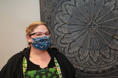 Candace H. Johnson-For Shaw Media Anna Haley Fielder, organizer of the Mask Brigade, wears one of the masks she has made at her home in Antioch. Fielder works with several sewers making masks using quilting quality cotton fabrics which have been purchased or donated. (3/26/20)