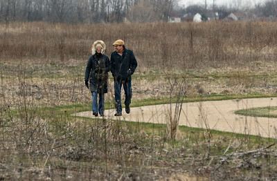 Candace H. Johnson-For Shaw Media Veronica Szmigiel and Daniel Goehry, both of Wildwood go for a walk at the Rollins Savanna Forest Preserve in Grayslake.(3/31/20)