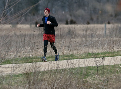 Candace H. Johnson-For Shaw Media Matt Taylor, of Grayslake goes running on the trail at the Rollins Savanna Forest Preserve in Grayslake.The  main entrance to the forest preserve is located on Washington Street in Grayslake.