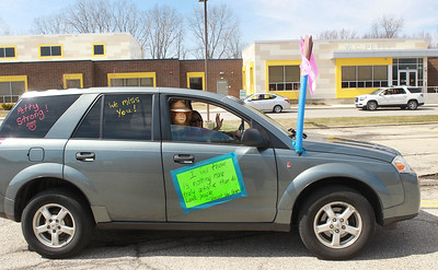 Candace H. Johnson-For Shaw Media Cheryl Jerik, of Antioch, an art teacher, put a quote from Vincent Van Gogh on her car to inspire her students as she waves while taking off for the Petty's Staff Parade at the W.C. Petty Elementary School in Antioch. (3/25/20)