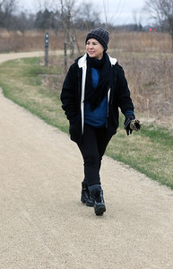 Candace H. Johnson-For Shaw Media Lupe Lara, of Waukegan goes for a walk on the gravel trail at the Rollins Savanna Forest Preserve in Grayslake. The forest preserve has 5.5-miles of gravel trail.