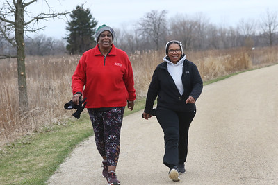 Candace H. Johnson-For Shaw Media Michelle Jones and Beryl Washington, both of Gurnee go for a walk together at the Rollins Savanna Forest Preserve in Grayslake. The forest preserve has a 5.5-mile gravel trail. (3/31/20)