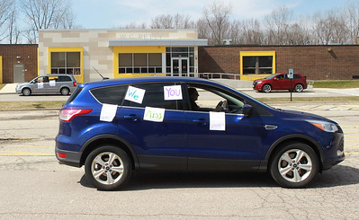 Candace H. Johnson-For Shaw Media Kaitlin Pucci, of Round Lake, band teacher, covered her car with positive messages, as she takes off to tour the community waving to her students during the Petty's Staff Parade at the W.C. Petty Elementary School in Antioch. (3/25/20)