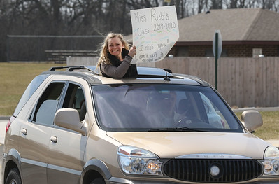 Candace H. Johnson-For Shaw Media Courtney Rieb, of Antioch, a fourth grade teacher, shows off the sign she will be holding when she goes throughout the community to see her students during the Petty's Staff Parade at the W.C. Petty Elementary School in Antioch. (3/25/20)