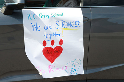 Candace H. Johnson-For Shaw Media 5th grade teacher, Mrs. Rivera, shows her support with a sign on her car before the Petty's Staff Parade takes off to make their way through the community to wave to their students at the W.C. Petty Elementary School in Antioch. (3/25/20)