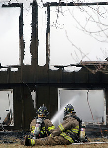 Sarah Nader - snader@nwherald.com Firefighters put out a fire that engulfed a home on Maretta Drive in Crystal Lake on Sunday, March 20, 2011. The fire stated around 4 p.m. after lighting possible struck the home.