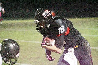 Don Lansu for the Northwest Herald.Huntley's Bryce Beschomer prepares to take the hit from the McHenry defender after a sizeable catch and run during 1st half action in Huntley 10/19/2012