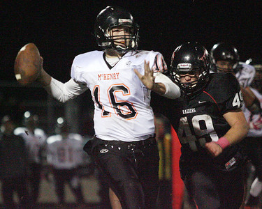 Don Lansu for the Northwest Herald.McHenry Quarterback Mike Briscoe (16) is chased from the pocket by Huntley Red Raider (# 49) Josh Fish during 1st half action at Huntley 10/19/2012.