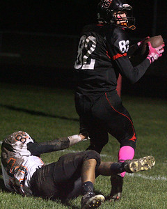 Don Lansu for the Northwest Herald . Huntley's Jake Lacovic (82) hauls in a  31yd. touchdown pass  against McHenry cornerback Jake Braskett (85) during action in Huntley 10/19/2012.