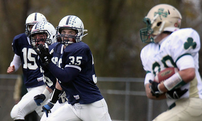 Jeff Krage – For the Northwest Herald Cary-Grove's Patrick O'Malley (#35) chases after a St. Patrick's John Dabe during Saturday's IHSA class 6A second-round playoff game. Cary 11/3/12