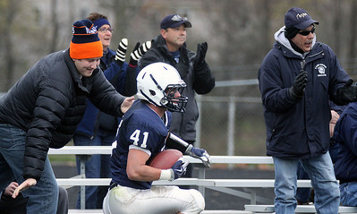 Jeff Krage – For the Northwest Herald Cary-Grove's Zach Marszal is congratulated in the end zone after scoring a touchdown with 1:13 remaining in the first quarter of Saturday's IHSA class 6A second-round playoff game against St. Patrick. The Trojans led 21-7. Cary 11/3/12