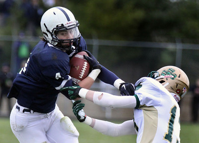 Jeff Krage – For the Northwest Herald Cary-Grove's Ryan Mahoney is grabbed by St. Patrick's Patrick Gill during Saturday's IHSA class 6A second-round playoff game. Cary 11/3/12