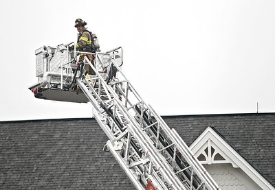 Josh Peckler - Jpeckler@shawmedia.com A firefighter with the Crystal Lake Fire Department goes up in the basket of a ladder truck to inspect the roof at Sunrise Senior Home in Crystal Lake after a report of smoke was reported.