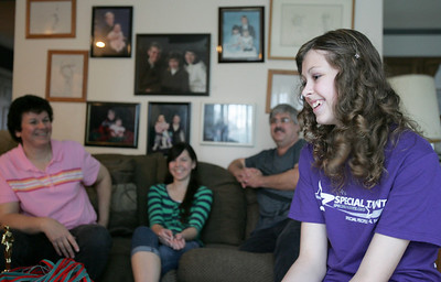 """Monica Maschak - mmaschak@shawmedia.com Breanna Bogucki, 15, shares a laugh with her family in their Cary home while talking about her experience competing in and winning Special Talents America, a talent competition for kids with special needs. Bogucki, who has Obsessive Compulsive Disorder and high-functioning autism, beat out eight acts in the contest, which draws people from Michigan, Indiana and Illinois. Bogucki won the competition last week by singing Taylor Swift's """"Mean."""""""