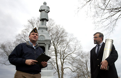 Monica Maschak - mmaschak@shawmedia.com Chris O'Connor, an Army Veteran and a member of the Crystal Lake Historical Society, leads a small time-capsule ceremony at the Union Soldier Statue at the Union Cemetery in Crystal Lake on Sunday, November 11, 2012.  The time capsule contains newsletter articles and photographs about the Union Soldier Statue, a list of local men who served in the Civil War and other historical items.  A brick will soon be placed at the base of the statue stating what date the time capsule should be opened.