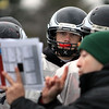 Jeff Krage – For the Kane County Chronicle<br /> Aurora Christian defensive end Jonah Walker gets instruction on a play during Wednesday's football practice.<br /> Aurora 11/7/12