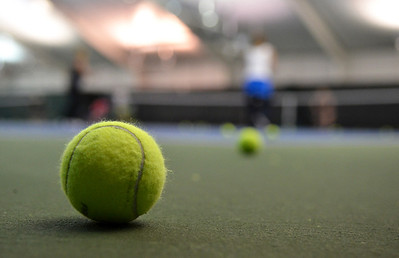 Monica Maschak - mmaschak@shawmedia.com Tennis balls occupy the outskirts of a tennis court during practice sessions at The Racket Club in Algonquin on Monday.
