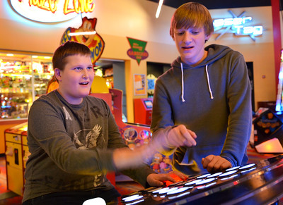 Monica Maschak - mmaschak@shawmedia.com Kenny Sulikowski (left) plays a Deal or No Deal arcade game with his peer buddy Will Hupp at the Brunswick Zone in Algonquin on Thursday, November 15, 2012.  The Best Buddies club at Crystal Lake South, where peer buddies are matched with special needs students, tries to have monthly outtings for the kids to hang out and have fun together.