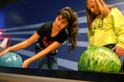 Monica Maschak - mmaschak@shawmedia.com Valerie Latala (left) picks a bowling ball with her peer buddy Nina Dimarco at Brunswick Zone in Algonquin on Thursday, November 15, 2012.  Latala and Dimarco are part of the Best Buddies Club at Crystal Lake South, where kids are paired up with special needs students who they spend time with throughout the year.