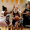 Paige Jordan of St. Charles East shoots the ball during their Schaumburg Thanksgiving Girls Basketball Tournament game against Schaumburg Tuesday night.