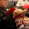 Three-year-old Parker Eisenmenger listens as Judge Robert Morrow reads a story during the annual Family Reading Night with the Judges at the Kane County Courthouse Wednesday evening.
