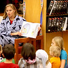 Judge Kathryn Karayannis reads a story during the annual Family Reading Night with the Judges at the Kane County Courthouse Wednesday evening.