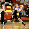 Amanda Hilton of St. Charles East passes the ball during their Schaumburg Thanksgiving Girls Basketball Tournament game against Schaumburg Tuesday night.
