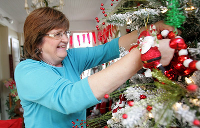 Monica Maschak - mmaschak@shawmedia.com Interior Designer and owner of Blooms & Rooms Joyce Miller-Konstantinow adds ornaments and decorations to a Christmas tree on Thursday, November 15, 2012. Blooms & Rooms shares the McHenry store with The Woodshop, owned by Robert Novak.