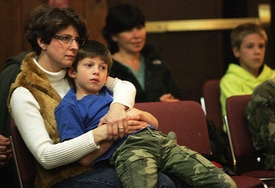 Monica Maschak - mmaschak@shawmedia.com Kim Koy, of Cary, holds her seven-year-old son, James Koy, while listening to six storytellers from the McHenry County Storytelling Guild at the Prairieview Education Center Saturday night.  The Guild and the McHenry County Conservation District hosted this fifth annual Tellabration Celebration to be part of a worldwide event where storytellers all tell stories on the same weekend.